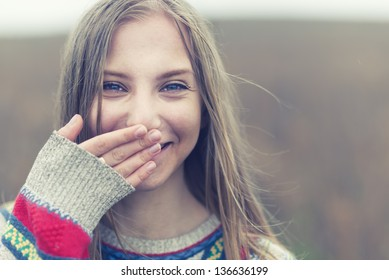 portrait of a beautiful happy smiling girl outdoors in spring