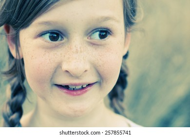 portrait of a beautiful happy smiling girl outdoors