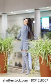Portrait of beautiful happy stylish woman in dress and trendy shoes with high heels, walking in city shopping center. Fashion woman lifestyle. Woman style, trendy outfit.