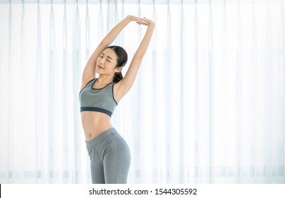Portrait of beautiful healthy armpit waxing asian woman with sport wear on white background. People beauty perfect body slim fit. Happy sexy girl relax copy space. Lifestyle healthcare fitness concept