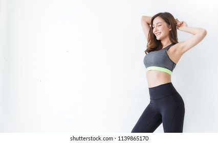 Portrait of beautiful healthy asian armpit waxing woman sport wear copy space white background. People beauty perfect body slim fit fitness sexy girl happy relax. Freedom lifestyle healthcare concept