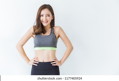 Portrait of beautiful healthy asian woman body curve with sport wear copy space on white background. People beauty perfect body slim fitness sexy girl. Freedom happy relax lifestyle healthcare concept