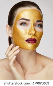 Portrait Of Beautiful Healthy Girl With Beauty Gold Mask.