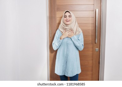 portrait of beautiful housewife wearing hijab with feel relieve expressions