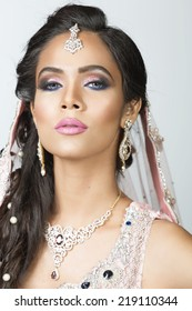 portrait of a beautiful Indian bride wearing traditional eastern outfit.