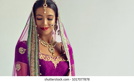Portrait of beautiful indian girl. Traditional India costume lehenga choli or sari.