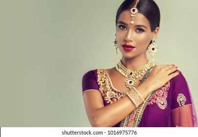 Portrait of beautiful indian girl. Young hindu woman model. Traditional India costume lehenga choli or sari