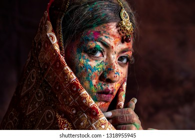 Portrait beautiful indian girl. Young indian with  Traditional Indian costume and holi powder. India women with copy space.