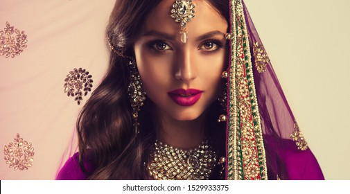 Portrait of beautiful indian girl . Young hindu woman model  in sari and  kundan jewelry . Traditional India costume lehenga choli . Eastern or Arabic culture.