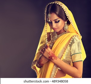 3f91eb70f5 Portrait of beautiful indian girl . Young hindu woman model with tatoo  mehndi and kundan jewelry
