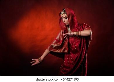 Portrait of beautiful indian girl . Young hindu woman model kundan jewelry . Traditional costume