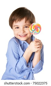 Portrait of beautiful joyful little boy with lollipop isolated on white background