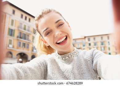 Portrait of beautiful joyful tourist woman hands holding smart phone photo camera, taking selfies pictures on holiday destination, smiling looking outdoors. Travel technology recreation lifestyle fun.