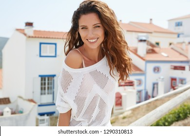 Portrait of a beautiful joyful young woman. Smiling girl.