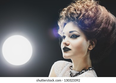 Portrait of a beautiful lady with an fashionable hairstyle