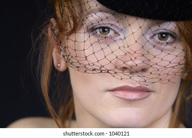 portrait of a beautiful lady in hat with veil