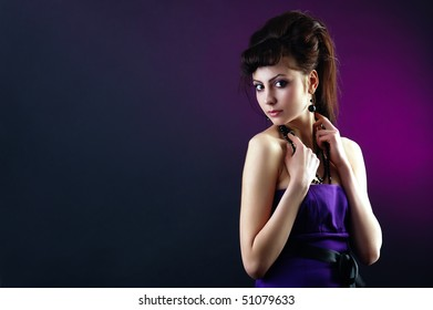 The portrait of a beautiful lady wearing a lilac dress