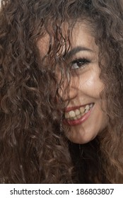 Portrait of Beautiful latin girl with her hair over her face