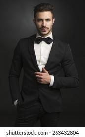 Portrait of a beautiful latin man smiling wearing a tuxedo