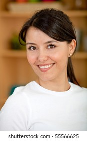 portrait of a beautiful latin woman smiling indoors