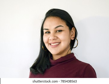 Portrait of beautiful latina businesswoman smiling- isolated