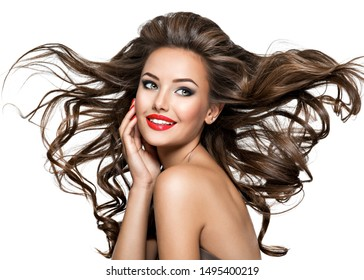 Portrait of beautiful laughing woman with brown long wavy hair and bright red lips looking at camera - isolated on white.