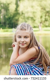Portrait of the beautiful litle girl in blue