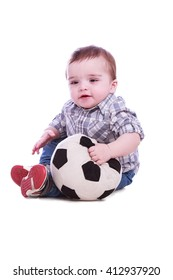 Portrait of beautiful little boy with a soccer ball