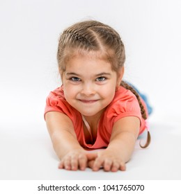 Portrait of a beautiful little cheerful girl. Child close up. Photo Indoors