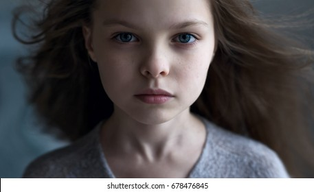 Portrait of beautiful little child girl. Facial expression. Kid and emotions.