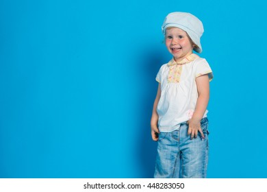 Portrait of beautiful little girl against blue background