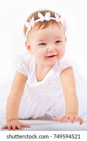 Portrait of a beautiful little girl. Child on a white background