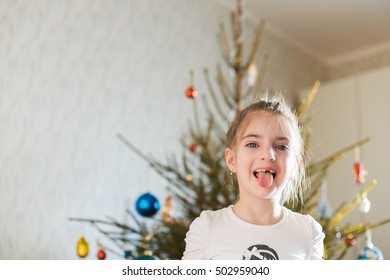 Portrait of beautiful little girl at christmas tree