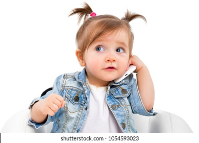 Portrait of a beautiful little girl, talking on the phone, isolated on white background