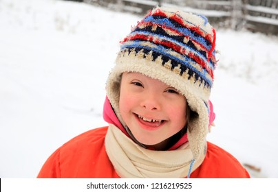 Portrait of beautiful little girl in the winter