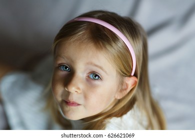 Portrait of a beautiful little Russian girl with white hair and gray eyes