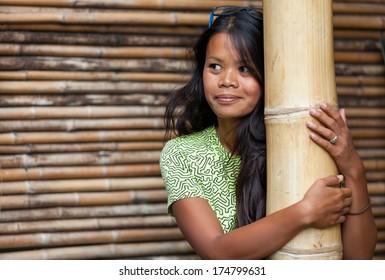 Portrait of beautiful long haired asian woman wearing sunglasses.