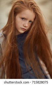 Portrait of beautiful longhair redhead girl. Autumn mood concept