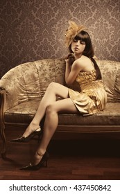 Portrait of a beautiful luxurious glamorous models in gold. Golden fashionable woman