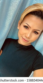 A portrait of an beautiful Malaysian Model. Pretty Asian woman with perfect discreet make up. Close up Female Asian face. Healthy skin care cosmetic.  Portrait of a young Woman with short blond hair.