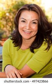 Portrait Of A Beautiful Mature Hispanic Woman Looking At The Camera