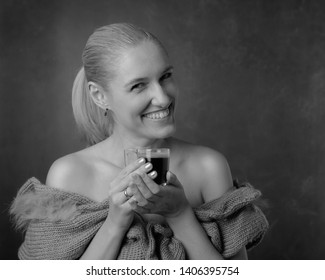 Portrait of a beautiful mature woman with cup of coffee. Attractive and happy blonde in bar drinks coffee. Black and white.
