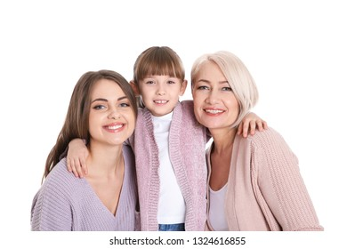 Portrait of beautiful mature woman with daughter and grandchild on white background