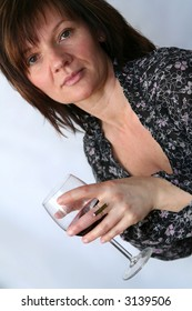 Portrait of a beautiful mature woman with glass of wine