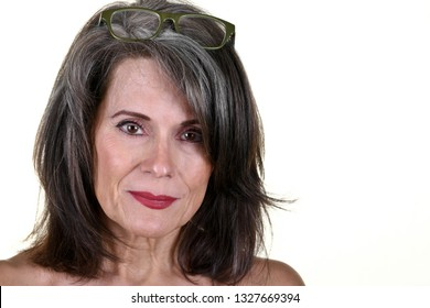Portrait of a Beautiful Mature Woman with Glasses on Top of Head