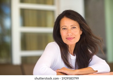 Portrait of a beautiful mature woman at home.