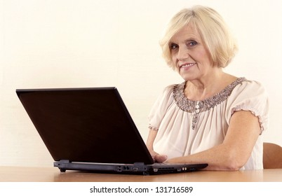 portrait of a beautiful mature woman on a light background