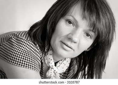 Portrait of a beautiful mature woman on a white background