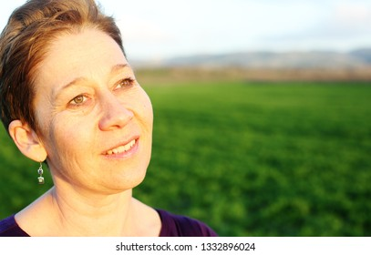 Portrait of beautiful mature woman outdoors