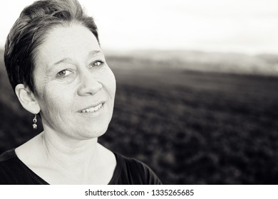 Portrait of beautiful mature woman outdoors